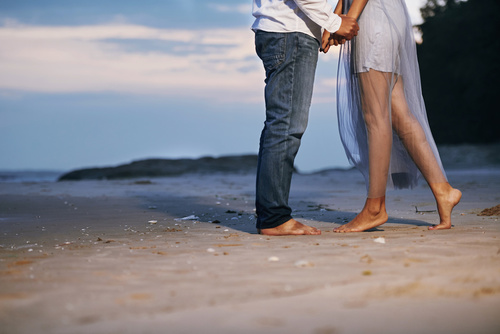 Couple in love standing on beach